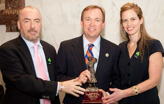 "South Carolina Congressman Mick Mulvaney accepts the ""Congressional Champion of Irish Culture Award\"" in 2014 from Irish Lobby for Immigration Reform Chairman Ciaran Staunton and U.S. Council on Irish Immigration President Margo Gaine."