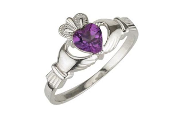 The claddagh birthstone ring for February features the famous Irish claddagh symbol, with an amethyst heart.