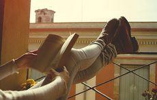 Thumb_reading_book_balcony_istock