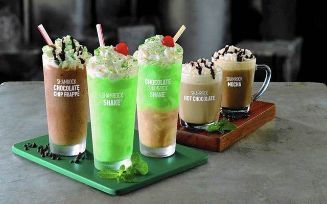 McDonalds is rolling out four new varieties of their seasonal shake this year: Shamrock Chocolate Chip Frappe, at left;  Chocolate Shamrock Shake, third from left; Shamrock Mocha, at right; and Shamrock Hot Chocolate, second from right. The Original green, mint-flavored shake is second from left.