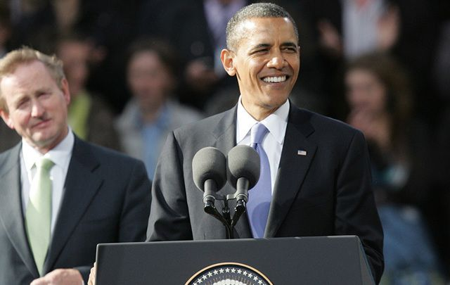 Barack Obama (right) and Enda Kenny stand before the crowds in Dublin in 2011. \n
