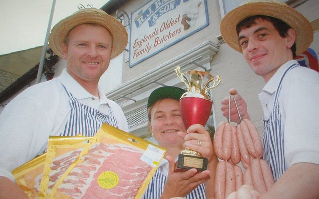 The Balson family pose outside the shop after bringing home the gold.