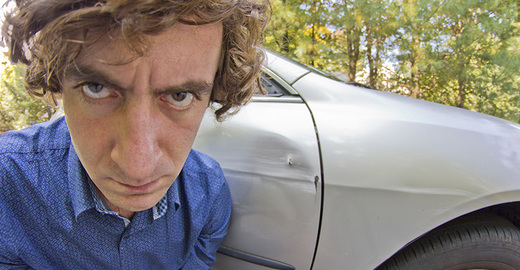 Cropped_driving_annoyed_man_green_istock