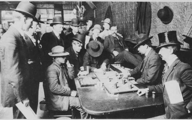 Irish gambler Johnny Murphy, one of the men who killed the notorious James Leavy, is seen in this staged photograph of a faro game at Bisbee's Orient Saloon around 1902 or 1903. Murphy is dealing faro second from right. The building is still in use today as Café Roka at 35 Main Street.