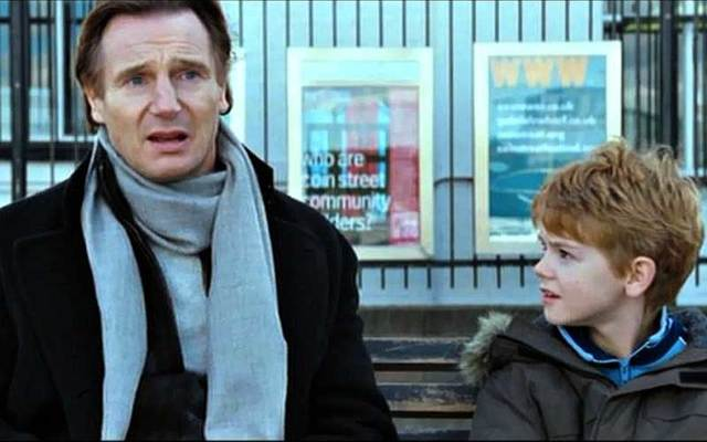 Screenshot of Liam Neeson with Thomas Brodie-Sangster in the 2003 hit movie 'Love Actually.'