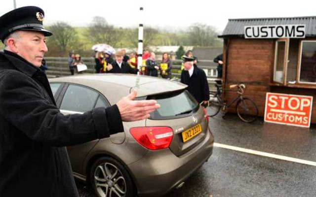 Protesters set up a mock checkpoint at the border between the Republic of Ireland and Northern Ireland on Saturday to show the potential impact of post-Brexit customs measures.