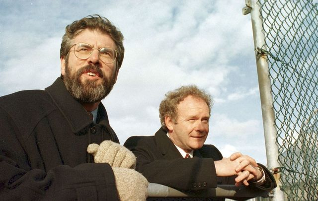 April 10, 1998: Sinn Fein President Gerry Adams with Chief Negotiator Martin McGuinness look over the wire in Stormont Castle after putting their final approval to the Good Friday Agreement.