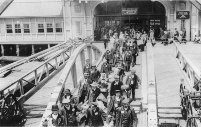 Immigrants arrive to Ellis Island, New York.