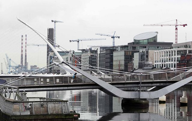 Construction cranes on the Quays in Dublin City in January.