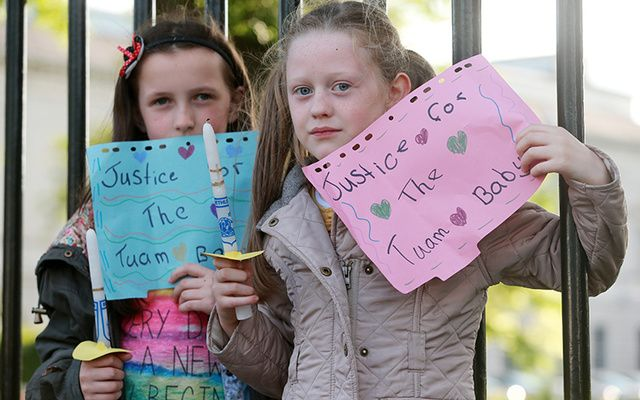 Amy Rose Hyland Holden (left, 10) and her cousin Abbie Conran (9) pictured on the railings at the back of Leinster House in 2014, where a vigil was held to demand justice for the mothers and children who endured cruelty at the hands of the State.