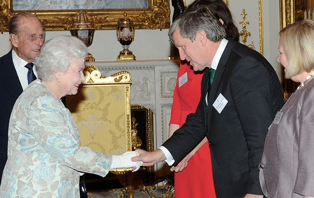 Former Ambassador to the United Kingdom Dan Mulhall shaking Queen Elizabeth II\'s hand.