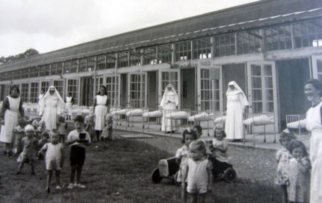 Children taking the area, supervised by nuns, at and Irish Mother and Baby Home.
