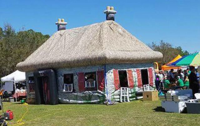 Donegal success story as couple take over the world with Irish inflatable party solutions the Pop-up Irish pub and thatched cottage.