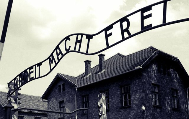 "A sign reading ""Arbeit macht frei"" (""Work sets you free"") hanging above the entrance to Auschwitz."