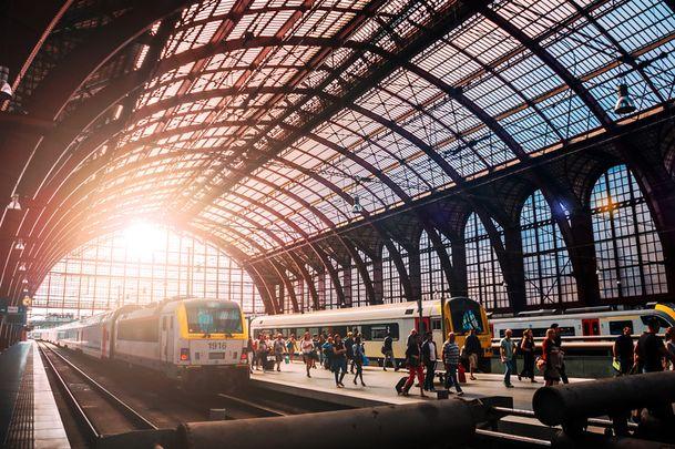 Trains and people boarding in the beautiful Antwerpen trainstation in Belgium.jpg