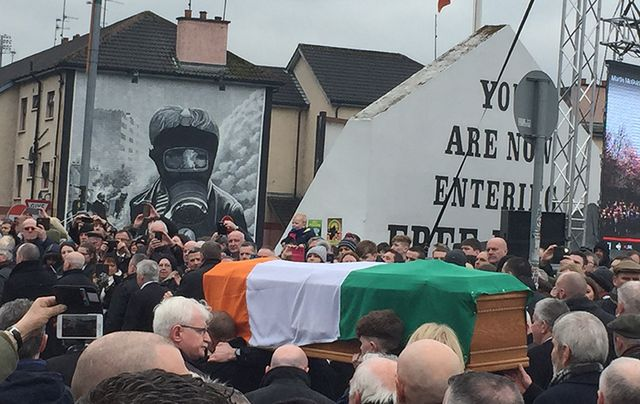 Martin McGuiness' funeral passes the iconic Free Derry corner.