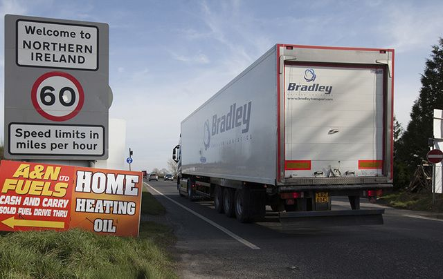 Commercial traffic from the Irish Republic passes an anti-Brexit sign last Friday, just inside the Northern Ireland border.