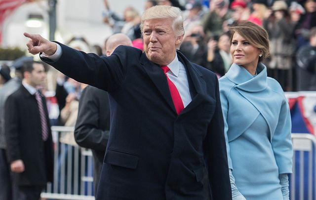 President Donald Trump and Melania greeting the crowds at his inauguration.