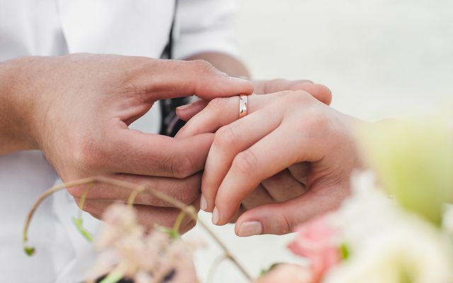 The exchanging of rings during a wedding ceremony.