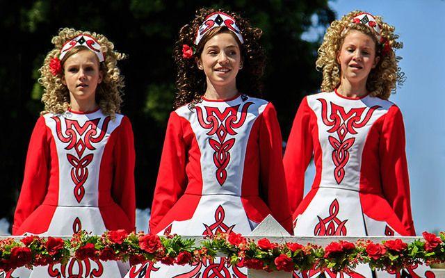 Irish dancers in red dresses.