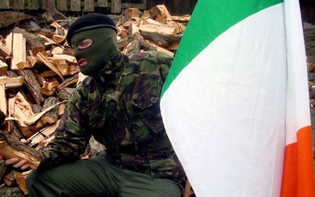 IRA member holding Irish tricolor.