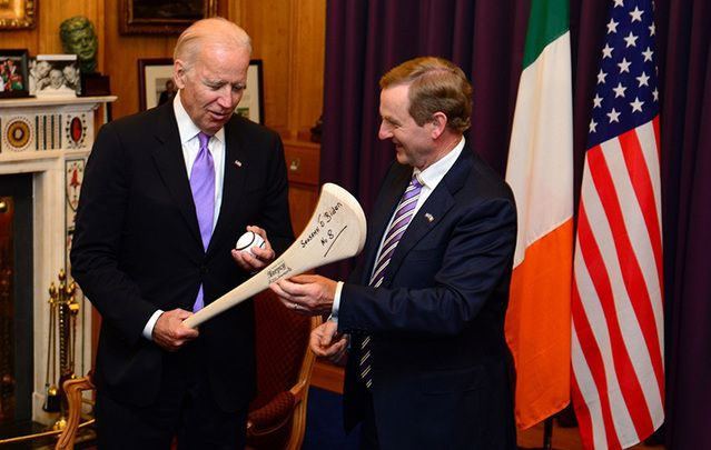Joe Biden is gifted a hurl and sliotar by the Irish leader Enda Kenny.