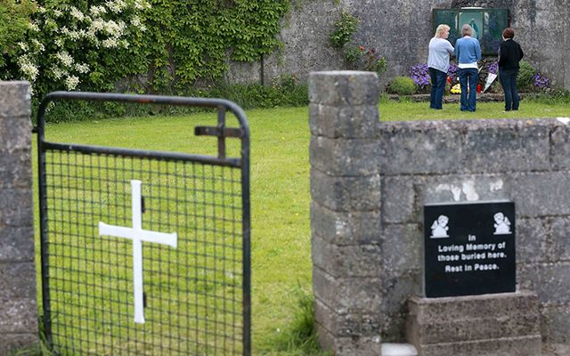 Members of the public pay their respects at the grounds where the unmarked mass grave containing the remains of nearly 800 infants who died at the Bon Secours mother-and-baby home in Tuam, Co. Galway.