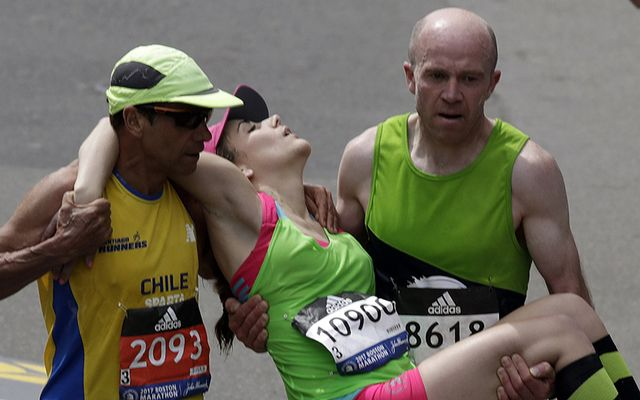Terry Canning and Mario Vargas carried Julianne Bowe up to the line of the Boston Marathon.