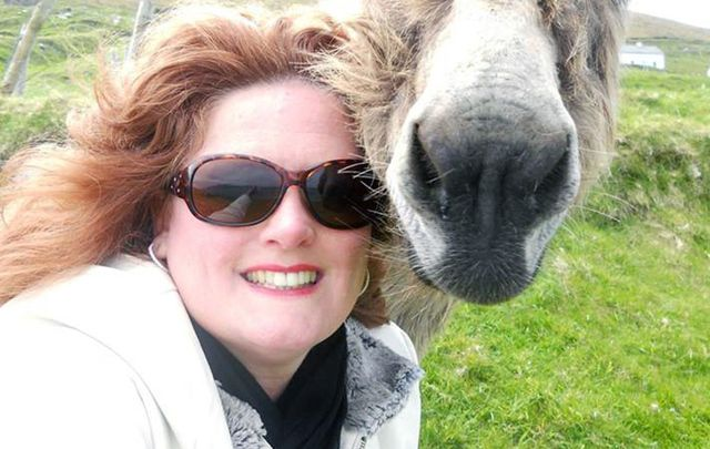 Kathleen Maloney (and a donkey) on a recent trip to Ireland.