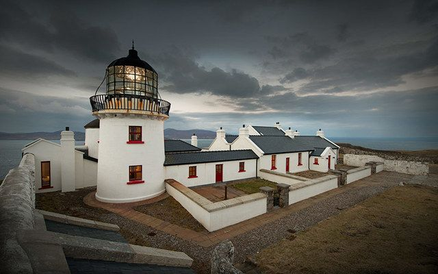Clare Island Lighthouse as night falls.