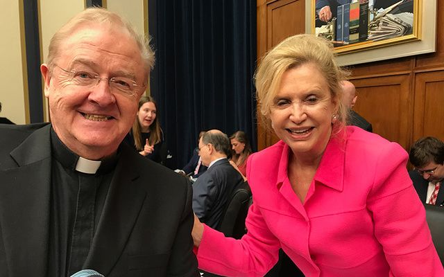 Congresswoman Carolyn Maloney and Fr. Sean McManus at one last week's two meetings of the House Financial Services Committee.
