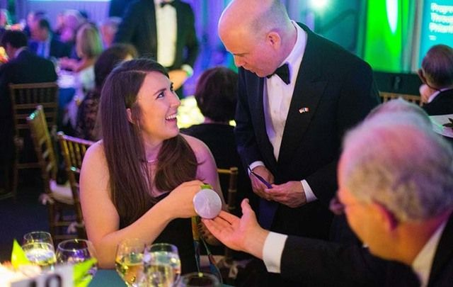 Ireland Funds Gala: Ireland's Silver Olympic Medalist Annalise Murphy, left, shows medal to Jim Rooney, son of the late Ambassador Dan Rooney, center, and David Donoghue, Ireland's ambassador to the United Nations.
