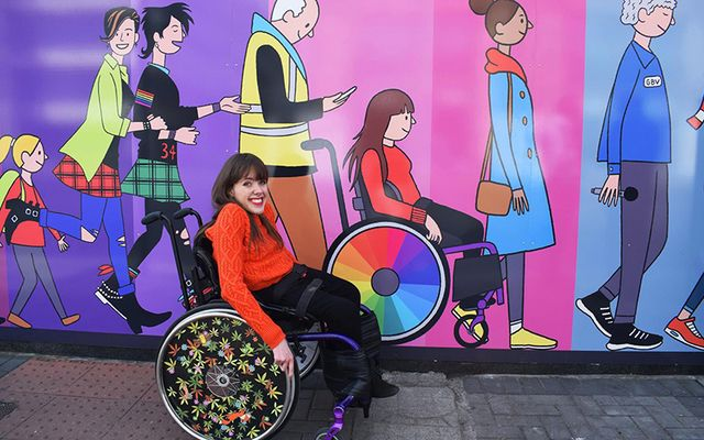 Isabel in front of a mural she\'s featured in by Chris Judge in the Dublin Docklands.