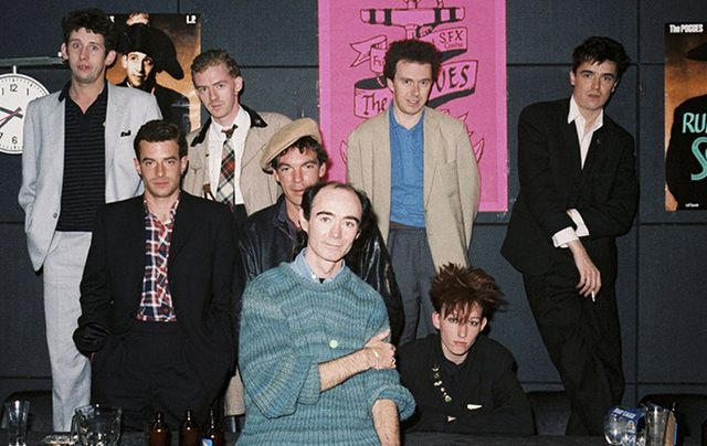 The Pogues, photographed with Irish DJ Fallon (front).