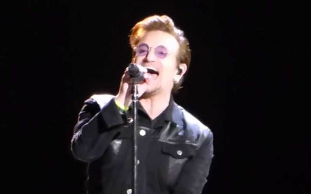 A snapshot of Bono singing during the opening night concert of U2\'s The Joshua Tree 2017 tour in Vancouver.