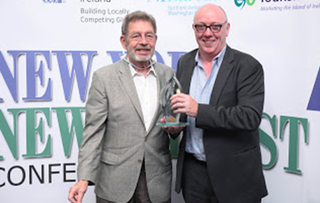 Oscar-winning Director and Belfast native Terry George (right) presents the Irish American of the Year Award to legendary author Pete Hamill - whose parents hailed from Belfast — at the 2012 New York-New Belfast Conference