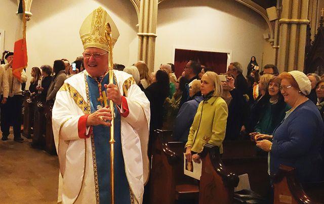 Cardinal Dolan at Mass.