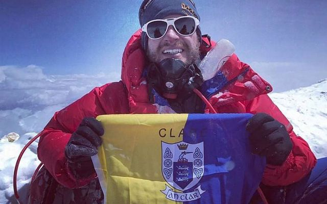 John Burke on the top of Mount Everest with the Clare flag.