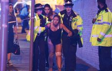 Thumb_mi_manchest_bombing_girl_cops_joel_goodman_lnp_rex_shutterstock