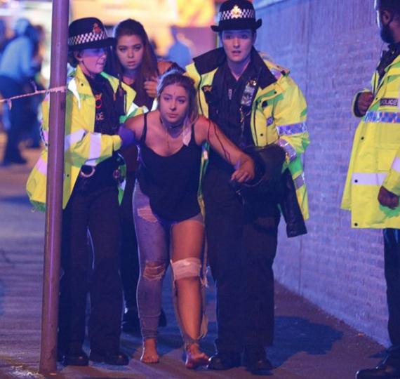 Cropped_t_manchest_bombing_girl_cops_joel_goodman_lnp_rex_shutterstock