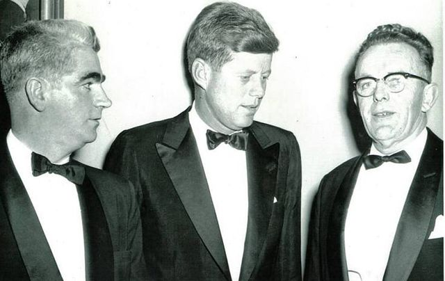 Sean P Keating (MC on the night, right), and Paul O'Dwyer, of the Irish Institute, flank Senator John F Kennedy.