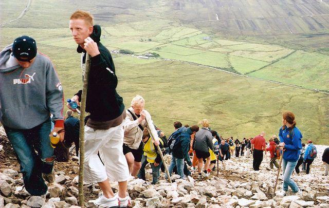 Pilgrims climb Croagh Patrick.
