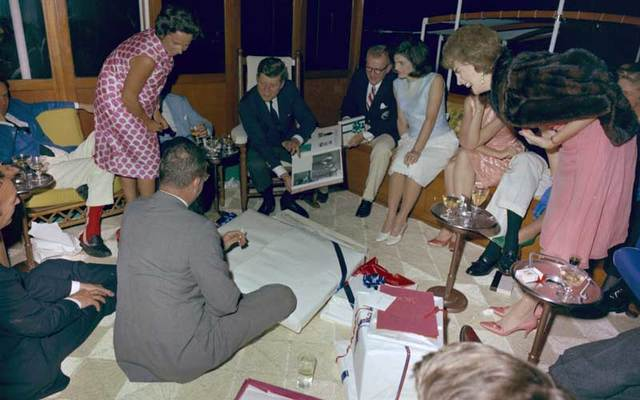 President John F. Kennedy opening birthday presents aboard the Sequoia in 1963.