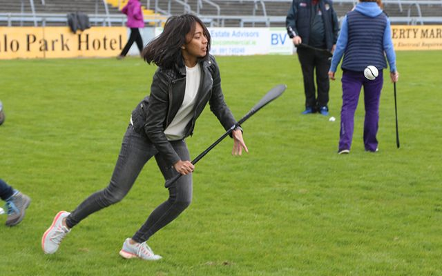 An international delegate learns some hurling skills at Pearse Stadium as part of the 2017 Climate Change, Agriculture and Food Security Conference in Galway.