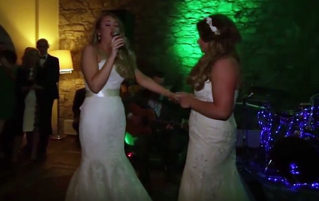 Heather sings to her new wife, Lauren, on the dance floor before their first dance.