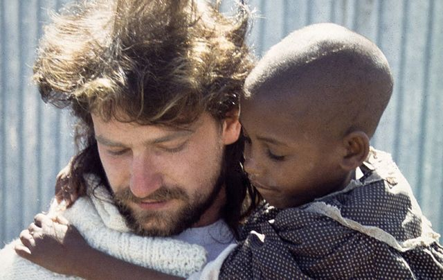 A Young Bono with a child he met on his first trip to Ethiopia in 1985.