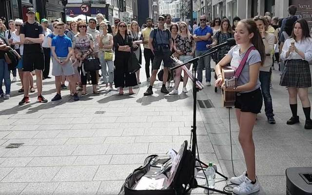 Twelve-year-old performer Allie Sherlock draws a crowd on Dublin's Grafton Street.