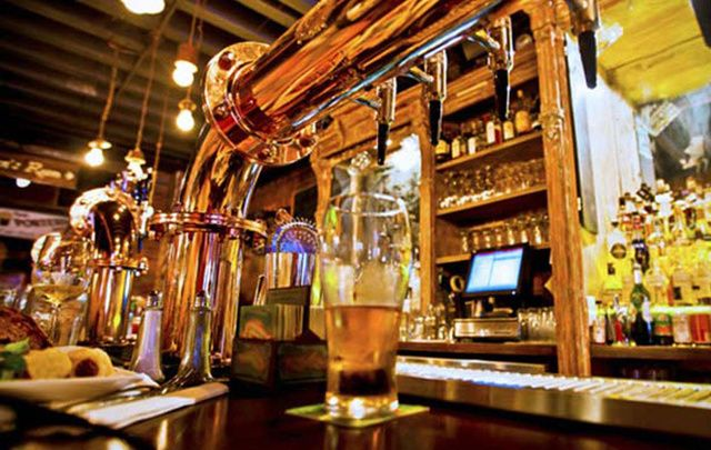 A glass of beer on a bar counter. The Irish pub is important to the country's economy, states a new report.