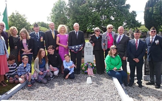 Michael Moffat\'s family and the American Legion at is newly erected headstone.