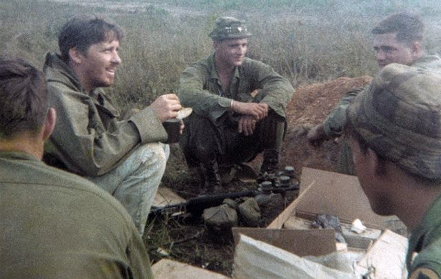 Chick Donohue, left, in Vietnam with his friends.